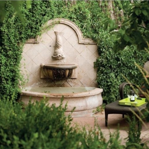 A fountain surrounded by ivy