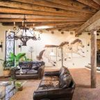 A living room with leather couches and vigas in Santa Fe