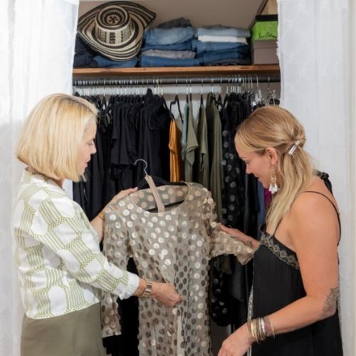 a style consultant helps a client organize her closet