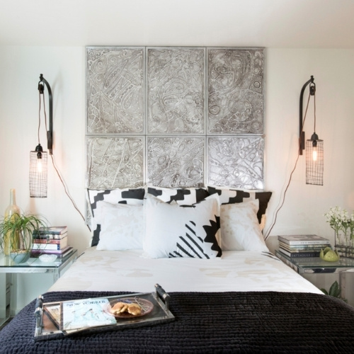 The master bedroom's focal point, a large six-panel art piece