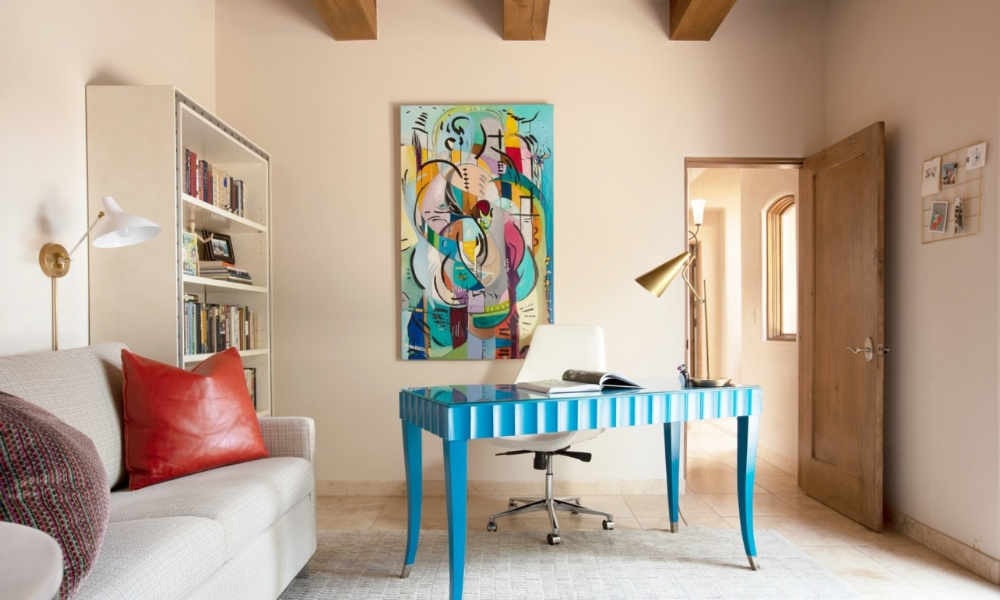 A cheerful office with bright blue desk.