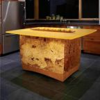A decorative kitchen island made from maple burl