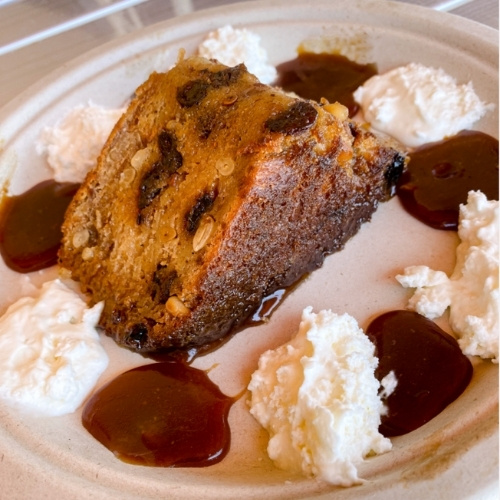 Dr. Field Goods' delectable bread pudding is made with piñon nuts, fresh caramel and whipped cream.
