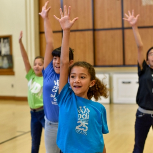 A group of students dancing with NDI New Mexico