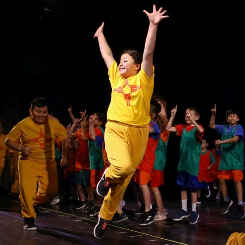 A student dancing with NDI New Mexico.