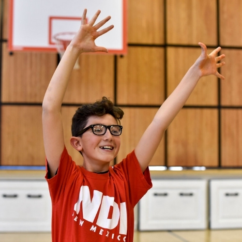 A student dancing with NDI New Mexico