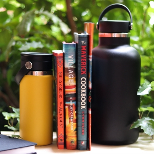 A collection of books and water bottles