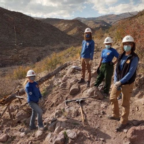 Rocky Mountain Youth Corps working on a trail