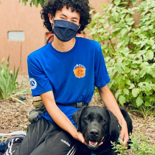 A Rocky Mountain Youth Corps member with a dog.