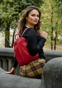 A woman wearing a red stylish backpack