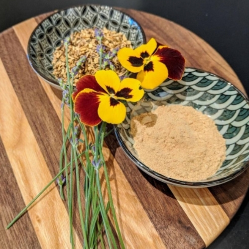 Two bowls with spices and pansies