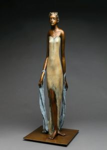 A bronze sculpture of a tall woman with a shawl