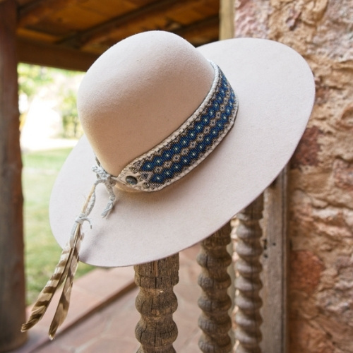 A white hat with a blue beaded band