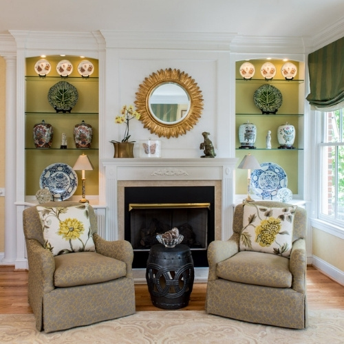 A living room with two chairs and green accents