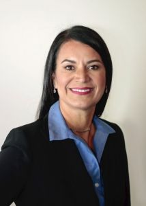 A woman in a blue shirt and blazer
