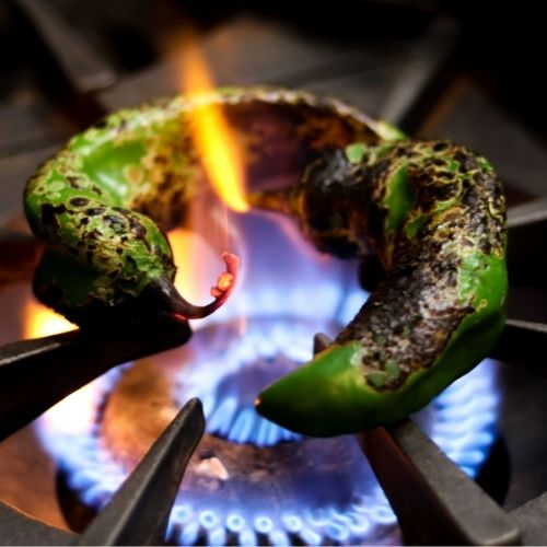 Roasting green chiles on a stove