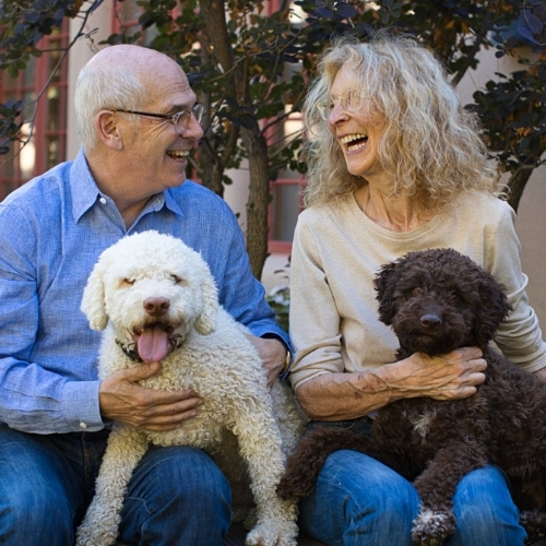 A portrait of Mayor Webber and his wife, holding their dogs