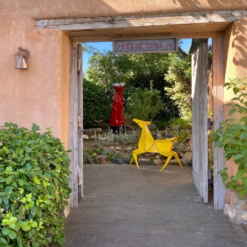 Two brightly colored sculptures in a courtyard