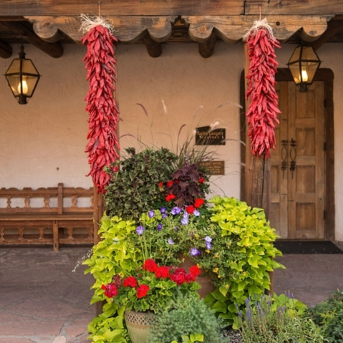 Flowers and ristras hung on a New Mexico portal