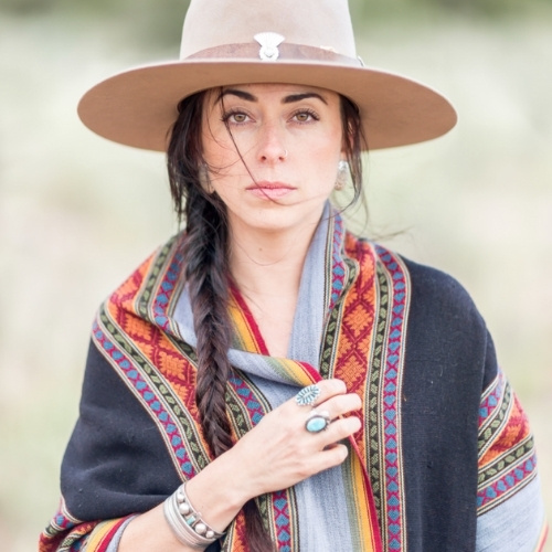A woman wearing southwestern styled clothing