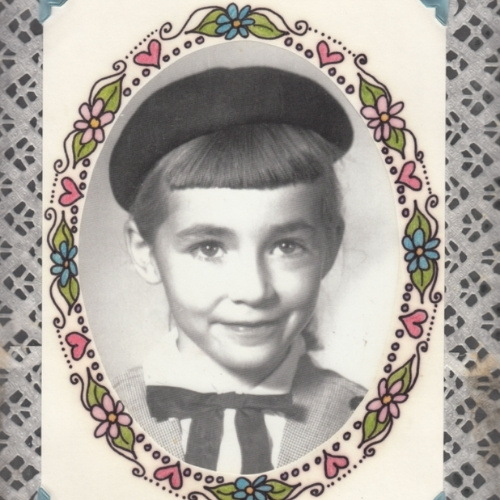 An old image of a young girl with a hat