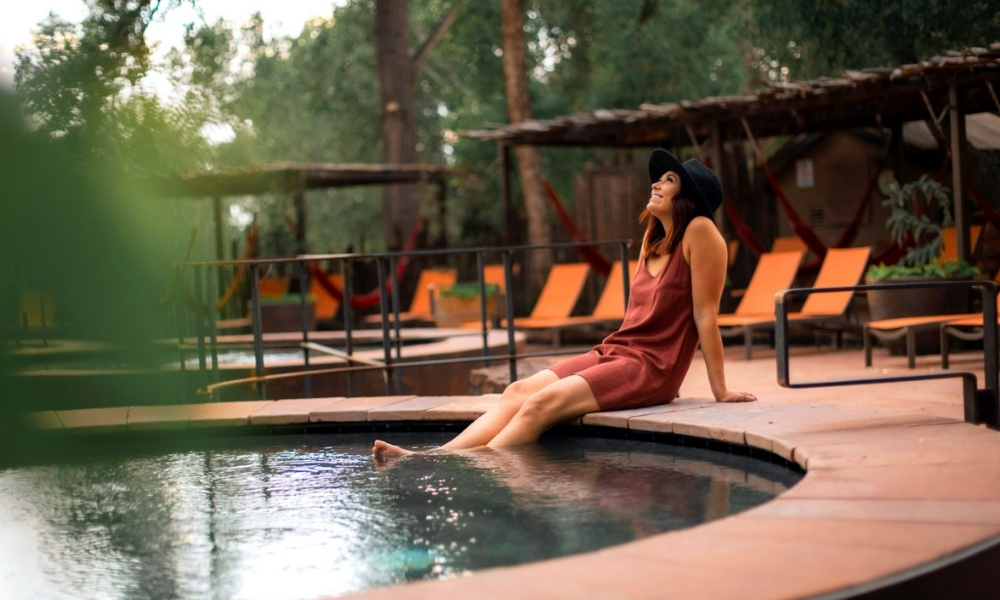 A woman soaking at Ojo Santa Fe Spa, formerly known as Sunrise Springs.