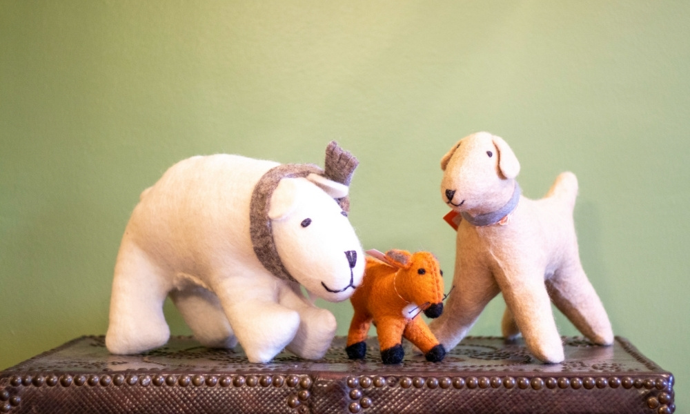 A collection of hand-felted stuffed animals