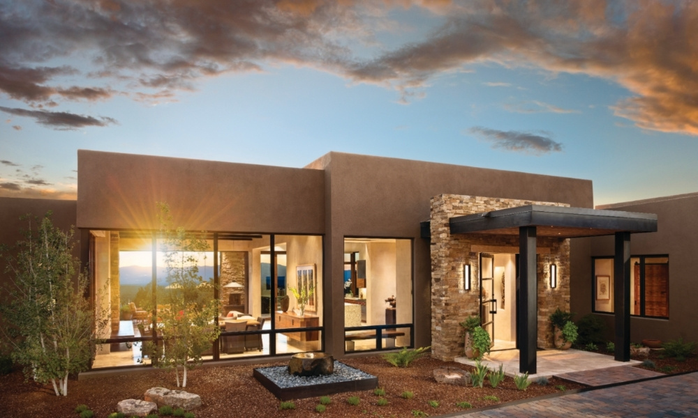 A southwestern home against a stunning sunset