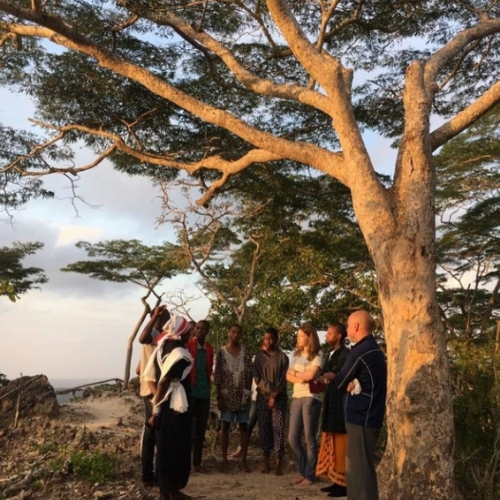 a group of people under a tree in Tanzania
