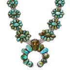 Squash blossom necklace in silver and turquoise by artist Charley Leekya.