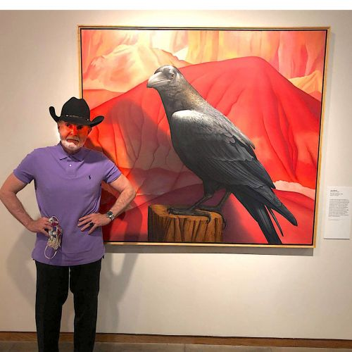 """Tom Palmore with """"Red Hills and Raven""""  at New Mexico Fine Art Museum."""
